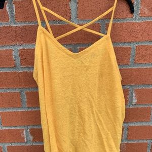 Flowy yellow tank top with cross back design